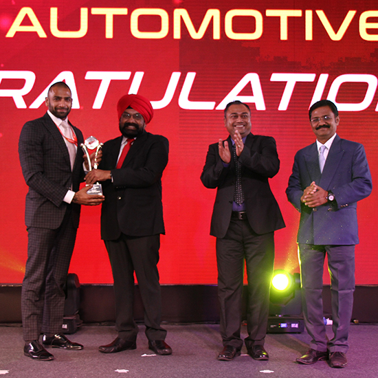 Mr Aditya receiving the award for best delivery management from Honda