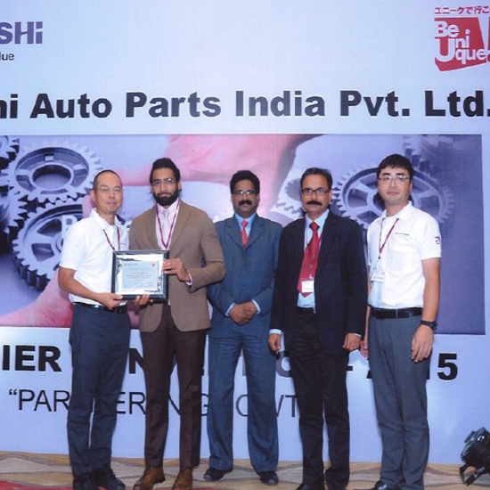 Mr Aditya Goyal receiving the recognition certificate for Best Supporting Supplier in QCDM from Musashi Auto Parts Pvt Ltd .